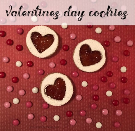 cookies on red background with chocolate candies