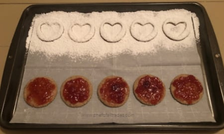 cookies on a cookie sheet being decorated