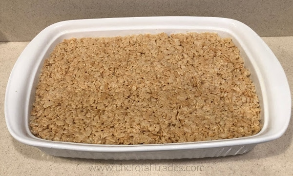 rice cereal treats in a white glass 9x13 casserole dish