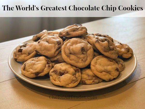 The World's Greatest Chocolate Chip Cookie recipe fresh out of the oven and stacked on a white