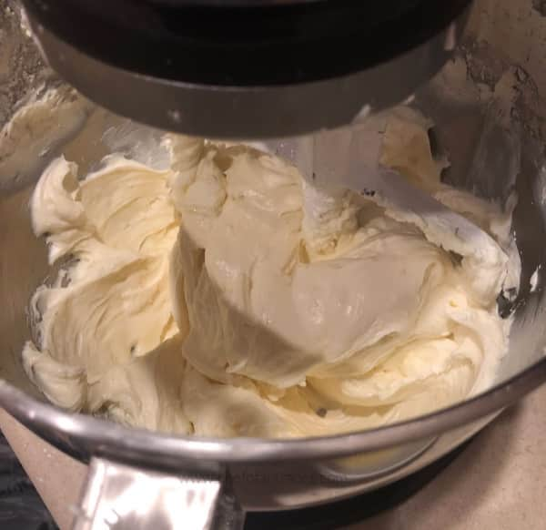 Cream cheese and sugar in mixing bowl