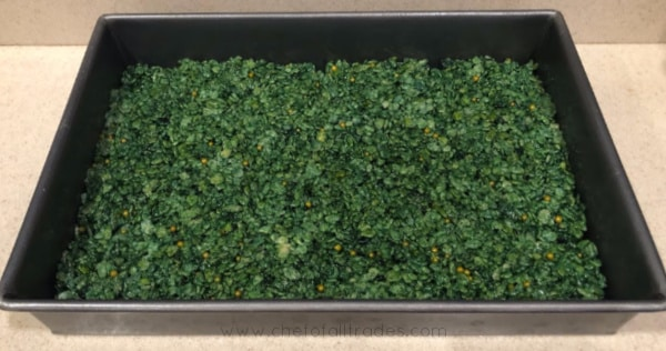 Green rice cereal treats in baking pan