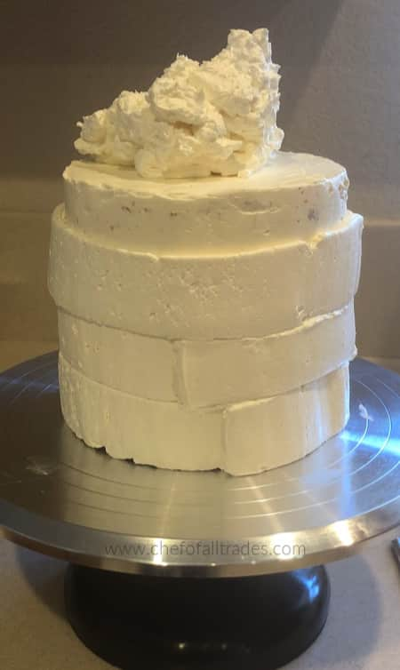 final icing a cake in a cake stand