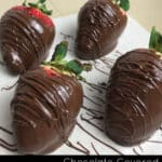Chocolate covered strawberries drying on parchment