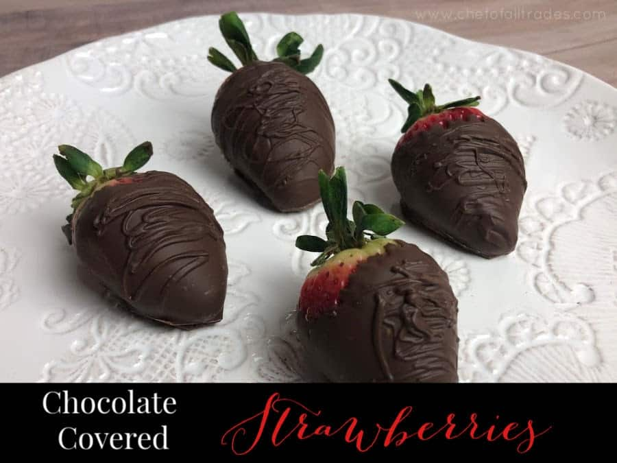Chocolate covered strawberries on a decorative white plate