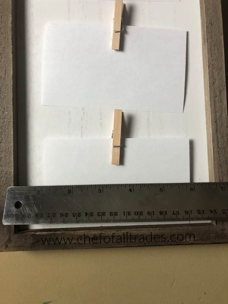 ruler on top of menu board to measure width