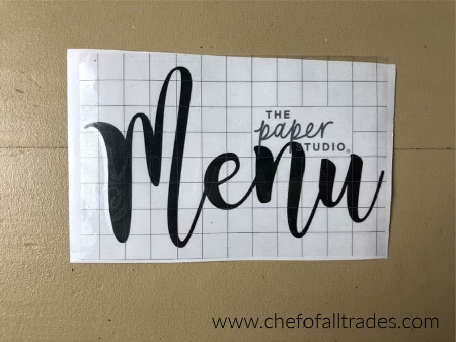 vinyl menu sign with transfer tape placed on top