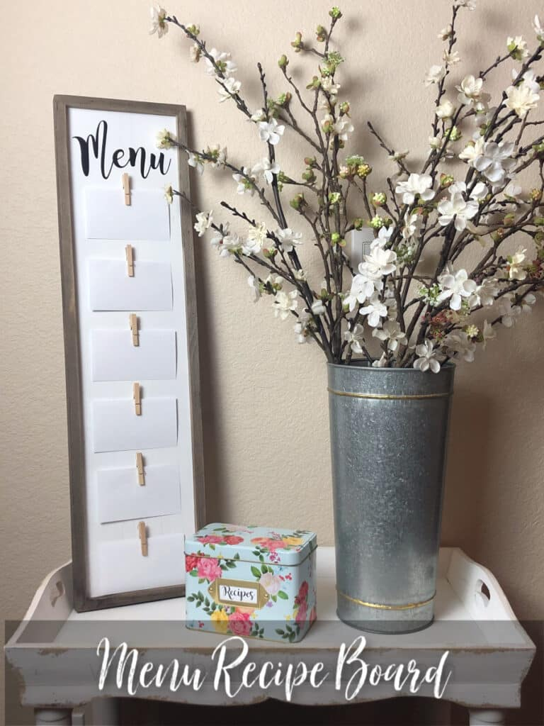 Menu Board on a table with flowers and a recipe box