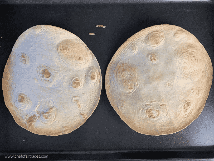 toasted tortillas on a baking sheet