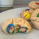Double Peanut Butter M&M Cookie Recipe with a glass of milk in the background