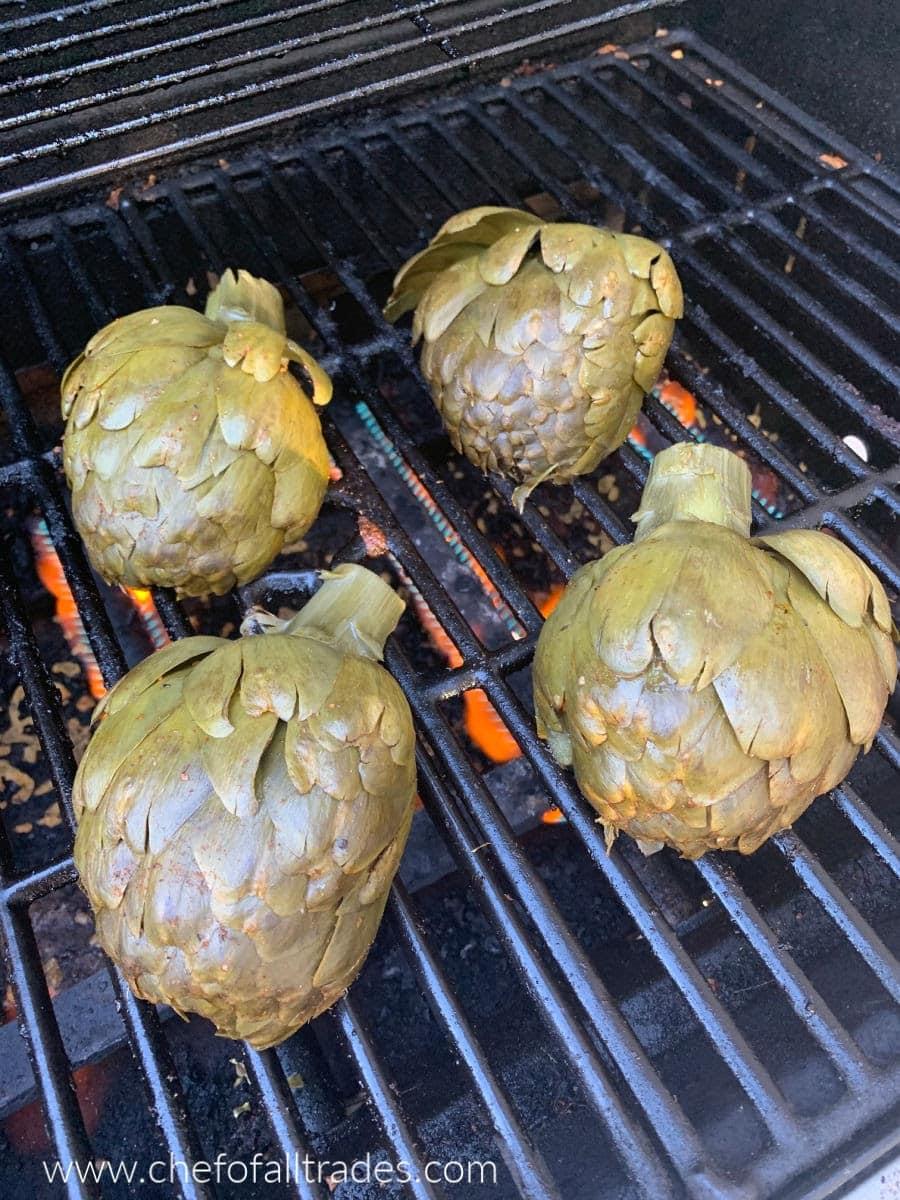 artichoke halves on a gas grill cut side down