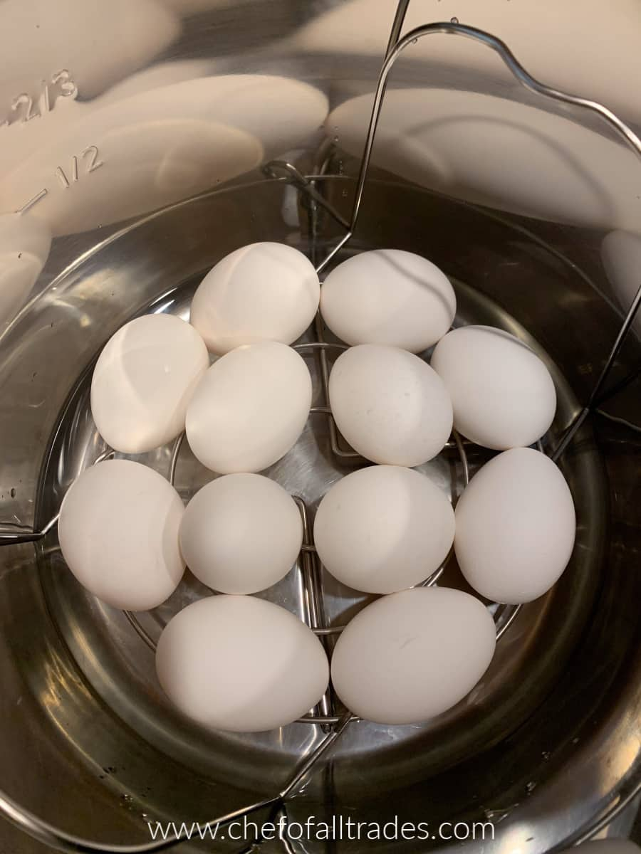 eggs stacked on a cooking rack inside the instant pot