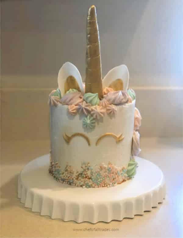 unicorn cake on a white ruffled platter