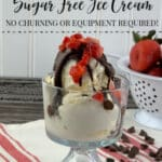 Sugar free vanilla ice cream in a clear glass bowl topped with strawberries and chocolate