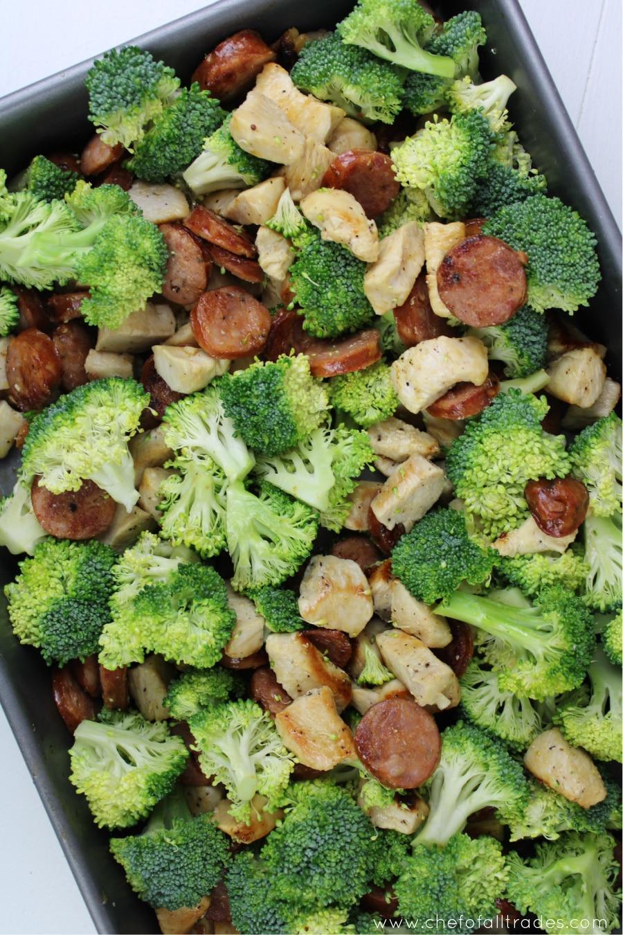 chicken broccoli and sausage mixed together in a casserole dish
