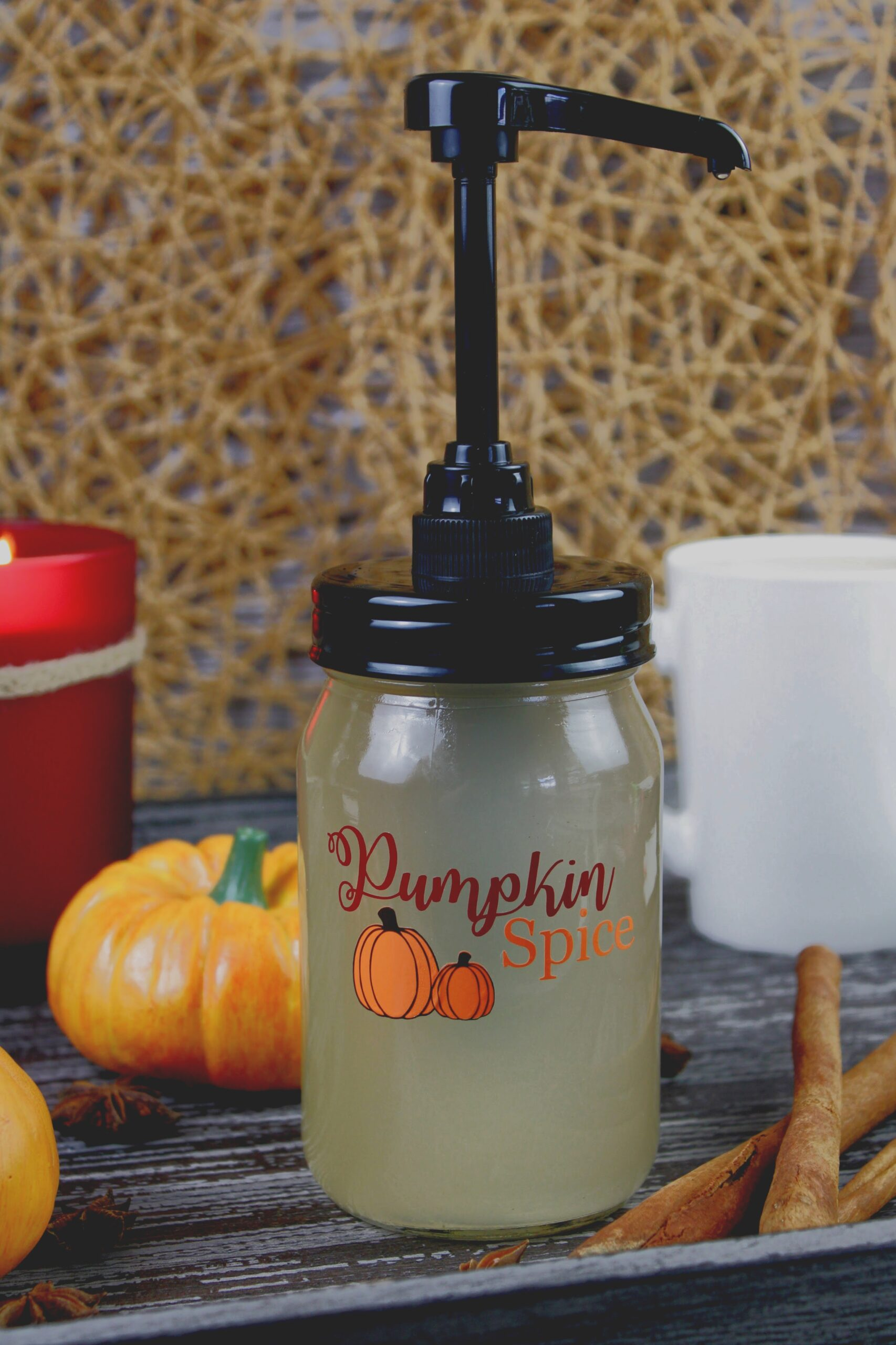 Sugar Free Pumpkin Spice Coffee Syrup in a labeled mason jar surrounded by fall decor
