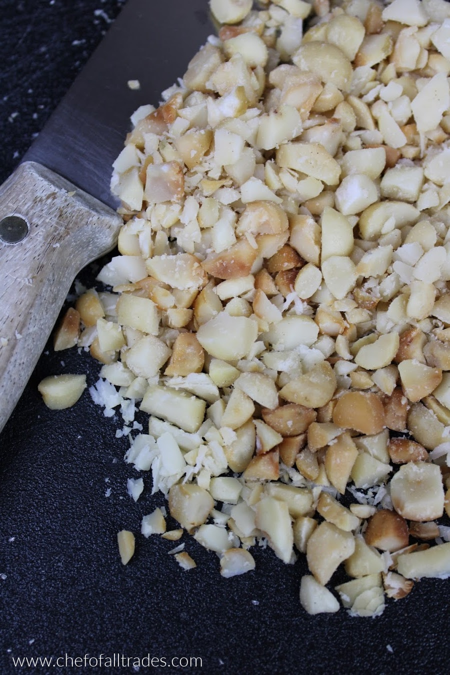 chopped macadamia nuts on a cutting board