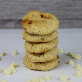 White Chocolate Macadamia Nut Cookies stacked on a white table