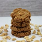 featured stack of peanut butter cookies surrounded by peanuts